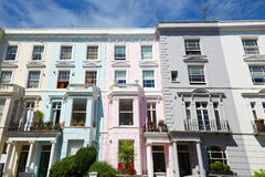 Colorful English houses facades in London, blue sky Royalty Free Stock Image