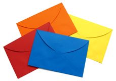 Colorful envelope - 4. A series of four bright envelopes (red, blue, yellow and orange), backside view, isolated on white with natural shadows royalty free stock image