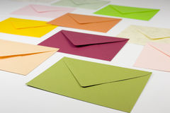 Colorful envelopes. Side view of colorful stationery - envelopes - green, red, yellow, pink and orange Stock Photos