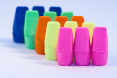 Colorful Erasers. With focus on the pink row Royalty Free Stock Image