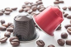 Colorful espresso coffee doses with coffee beans on. Closeup of colorful espresso coffee doses with coffee beans on white background stock photo