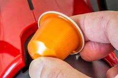 Colorful espresso coffee doses in hand. Closeup of colorful espresso coffee doses in hand stock photo