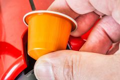 Colorful espresso coffee doses in hand. Closeup of colorful espresso coffee doses in hand royalty free stock photography