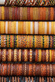 Colorful ethnic leather bracelets. Some colorful ethnic bracelets from north africa, at a fair, portrait cut Stock Photos