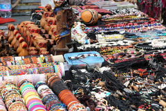 Colorful ethnic trinkets and sundries. Some colorful ethnic bracelets, trinkets and sundries, from north africa, at a fair, landscape cut Royalty Free Stock Image