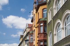 Colorful European Houses. Colourful European houses on a beautiful summer day, shot against the blue-white sky, a symbol of Bavaria in Germany, where this scene royalty free stock photos