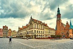 Colorful evening scene on Wroclaw Market Square with Town Hall. Sunset in historical capital of Silesia Stock Photography