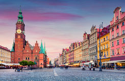 Colorful evening scene on Wroclaw Market Square with Town Hall. Royalty Free Stock Photos