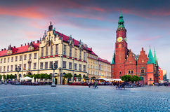 Colorful evening scene on Wroclaw Market Square with Town Hall. Royalty Free Stock Images