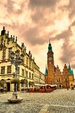 Colorful evening scene on Wroclaw Market Square with Town Hall. Sunset in historical capital of Silesia, Poland, Europe. Royalty Free Stock Photography