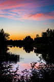Colorful evening sky. Fascinating colors reflecting of the river surface Royalty Free Stock Images