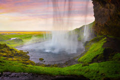 Colorful evening view from the middle of famous Seljalandfoss Wa stock images