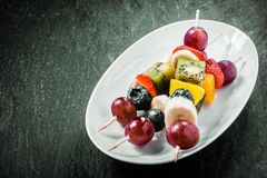 Colorful exotic fruit kebabs Stock Photography