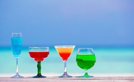 Colorful exotic tasty cocktails background Stock Images