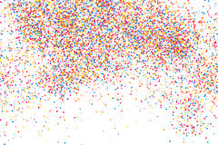 Colorful explosion of confetti.  Colored grainy texture vector. Colorful explosion of confetti. Grainy abstract  multicolored texture isolated on white Royalty Free Stock Images