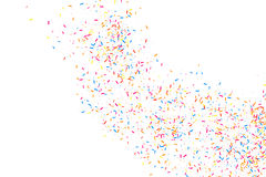 Colorful explosion of confetti.  Colored grainy texture vector. Colorful explosion of confetti. Grainy abstract  multicolored texture  on white background. Flat Stock Photography