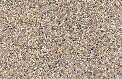 Colorful exposed aggregate concrete. With gray, brown and yellowish pebbles on a facade Stock Photo