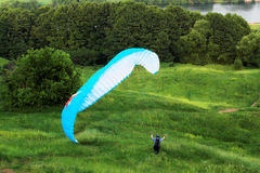 Colorful extreme paraglide on grass Stock Photo