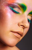 Colorful eye makeup. Portrait of attractive young woman with colorful eye makeup stock photo