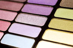 Colorful eye shadow set cosmetics. Macro colorful eye shadow set royalty free stock images