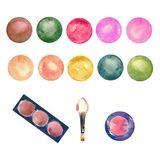 Colorful eye shadows boxes and multi color palettes with brush Royalty Free Stock Photos