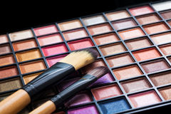 Colorful eye shadows palette with makeup brush. Colorful Makeup palette and brush Royalty Free Stock Image