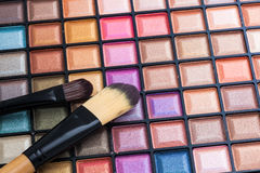 Colorful eye shadows palette with makeup brush. Stock Photos