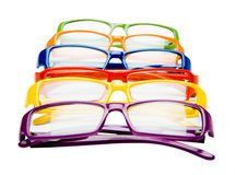 Colorful eyeglasses in row. Colorful eyeglasses in a row isolated over white Stock Photography