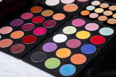Colorful eyeshadow palette and blush for make-up closeup. Colorful eyeshadow palette and blush for make-up royalty free stock photo