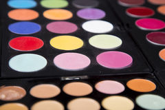 Colorful eyeshadow palette and blush for make-up closeup. Colorful eyeshadow palette and blush for make-up royalty free stock photos