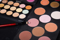 Colorful eyeshadow palette and blush for make-up closeup. Colorful eyeshadow palette and blush for make-up royalty free stock image
