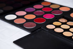 Colorful eyeshadow palette and blush for make-up closeup. Colorful eyeshadow palette and blush for make-up royalty free stock images