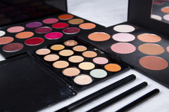 Colorful eyeshadow palette and blush for make-up closeup. Colorful eyeshadow palette and blush for make-up royalty free stock photography