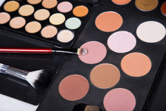 Colorful eyeshadow palette and blush for make-up closeup. Colorful eyeshadow palette and blush for make-up stock photo