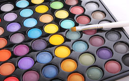 Colorful eyeshadow palette and brush Royalty Free Stock Photo