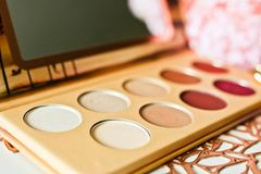 Colorful eyeshadow palette with mirror close up view. Trendy make up product stock photos