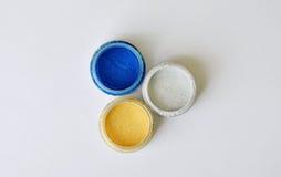 Colorful eyeshadow powder in bottle Stock Photos