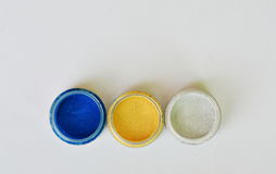 Colorful eyeshadow powder in bottle Royalty Free Stock Photography