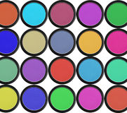 Colorful eyeshadows in black boxes isolated on white Stock Images
