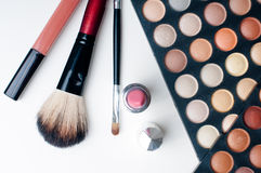 Colorful eyeshadows, lipstick and makeup brushes Stock Photo