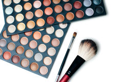 Colorful eyeshadows and make-up brushes Royalty Free Stock Photo