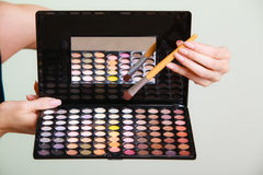 Colorful eyeshadows palette with makeup brush Royalty Free Stock Photos