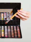 Colorful eyeshadows palette with makeup brush Royalty Free Stock Photography