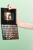 Colorful eyeshadows palette with makeup brush Stock Photography