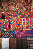 Colorful Fabric. Colorful Mexican patterned fabric hanging on a rack. Vertical shot Stock Images