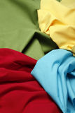 COLORFUL FABRIC. An assortment of colorful fabric in yellow, red and blue Royalty Free Stock Image