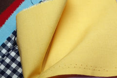 COLORFUL FABRIC. An assortment of colorful fabric in yellow, red and blue Stock Photos