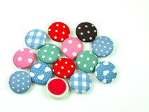 Colorful fabric buttons isolated Stock Photography