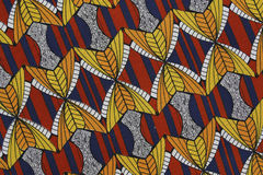 Colorful fabric. Close-up of a piece of fabric. The colors and patterns of the fabric are amazing. There is just so much detail in it stock image