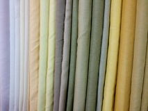 Colorful fabric clothes for sale at store stock images